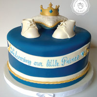 Prince Baby Shower Cake Had lots of fun making this cake. Personalized booties and gum paste crown.