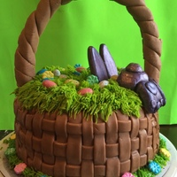Easter Basket Cake This is an Easter Basket Cake I made for my family. The basket weave, handle, and bunny are all made out of fondant. The grass is piped...