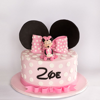 "Zoe's Minnie Mouse Cake   A 8"" chocolate cake, covered in ganache for Zoe's 1st birthday."