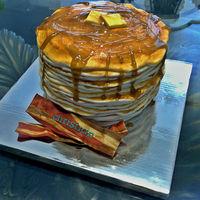 Stack Of Pancakes   A three layer cake crumb coated and wrapped in ropes of fondant. Syrup is a mixture of piping gel and maple syrup.
