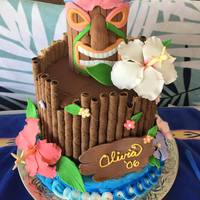 Luau Cake This is a luau cake I made based off of an idea my daughter found online. The top tier is chocolate and the bottom is vanilla.