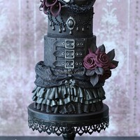 Gothic Wedding Cake With Top Hat I love making gothic cakes and black is my favorite colour. My newest love is top hats, so I combined the two. I hope you like the results...