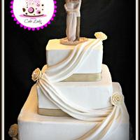 Square Wedding Cake   Butter cream wedding cake with fondant drape and gold ribbon