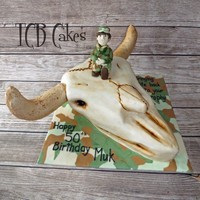 Buffalo Skull  Madeira Vanilla cake with Chocolate buttercream, covered with Chocolate ganache and finished with MMF. The character is edible and the...
