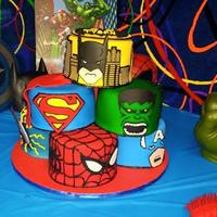 "Super Hero Cake Eight 6"" cakes. All covered in fondant with gumpaste decorations. See the video if the full cake here... https://www.facebook.com/..."
