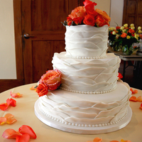 Ruffle Wedding Cake This was done for a dear friend's wedding. The top two layers are white almond sour cream and the base layer was cream cheese pound...