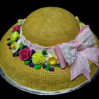 "Spring Hat  I used a large bevel pan to make the rim of the cake and carved a 7"" round cake for the top portion. The flowers are all buttercream,..."