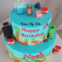 "Minecraft Cake 9"" n 6"" Marble with Strawberry filling, butter cream finished, all toppers are made of gum paste."