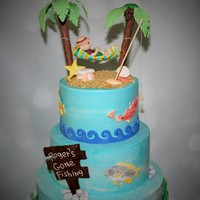 Retirement Cake- Gone Fishing 3 tier with gumpaste palm trees, man in hammock, fish and modeling chocolate sign