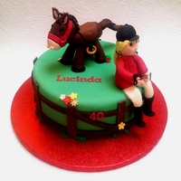 Horse And Rider Cake sugarpaste models of Lucinda and her horse on a vanilla bean sponge cake.