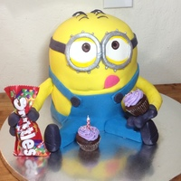 Minion Birthday Cake Chocolate cake with vanilla cream cheese frosting, decorated with a fondant/gumpaste mix.