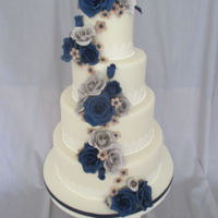 Navy And Gray Wedding Cake fondant covered with gum paste flowers