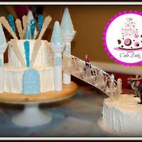 Frozen Themed Birthday Cake   I did this cake for my daughters 4th birthday. White cake with strawberry mousse filling.