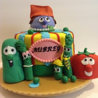 Veggie Tales Birthday Cake This is a Chocolate Cake/Chocolate buttercream covered in MFF. Bob, Larry and Madame Blueberry are Red Velvet Cake/Cream Cheese Frosting...