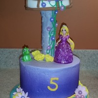 "Tangled 6"" 8"" cake with fondant tower. I used a paper towel covered in fondant and set the tower on top"