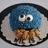 Cookie Monster Smash Cake Cookie monster smash cake. Piped buttercream with fondant mouth and googly eyes. Cookies are real chocolate chip cookies.