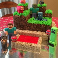 Minecraft Figures are all fondant, buttercream with crushed oreos/graham crackers to represent dirt, poured red sugar tiles for lava, rice krispie (...