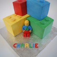 Lego Man Cake Each lego piece is covered in buttercream and carefully stacked. Lego man is fondant. The cake was really moist and difficult to work with...