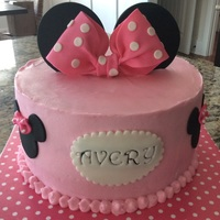 Minnie Mouse Cake 9in WASC with fresh strawberry buttercream filling. Covered in buttercream and fondant decorations.