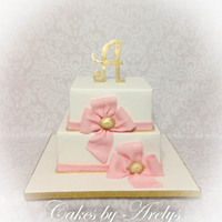 Pink Bows And Gold Initial Cake Pink Bows Quinceanera cake with gold initial topper and decorations. Marble cake filled with chocolate buttercream and a layer of white...