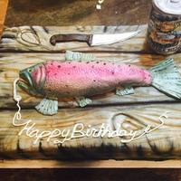 Rainbow Trout And Board Cake This cake was done for a surprise 40th for an avid fisherman. Everything is 100% edible. rainbow trout and beer can are rice crispies....