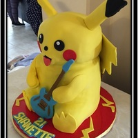 "Pikachu  Chocolate cake, covered with fondant. Made with two 6"" cakes and one 7"". height approximately 13"" (without ears) I first..."
