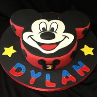 Mickey Mouse   Head, 8in round. Ears, 5in round. Covered in fondant.