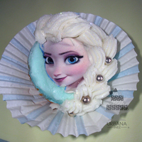 Elsa Cupcake Topper White Cupcake with Elsa's Face as a topper. Her braid is made with buttercream