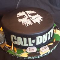 Calling All Call Of Duty Gamers!! This lucky little boy got a birthday cake fashioned after his favorite video game. The grenade is RKT covered in fondant with GP accents,...