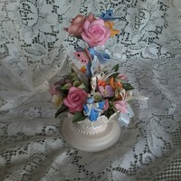 Miniature Floral Cake Topper Cake topper made out of gumpaste . Floral arrangement with beautiful gumpaste urn. Everything done in small scale to include blue bird,...