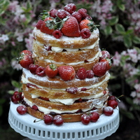 "Naked Cake This is my ""naked cake,"" quite a popular idea at the moment. The top tier is lemon and raspberry, filled with fresh..."