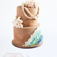 Stylized Beach Cake A beach inspired beach cake with ruffled waves.