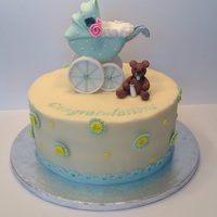 Baby Shower Buttercream cake. Baby stroller made from rice Krispy and gum paste.