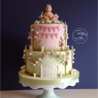 Enchanted Garden Baby Shower Cake Jo wanted a pretty garden themed cake to celebrate the imminent arrival of her little girl, so this two tier vanilla cake was covered in...