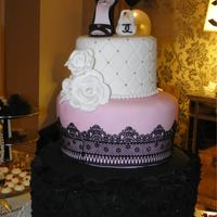 Chanel Cake Sweet three layers the bottom in black with modern petal design with relief.the second layer pink lace veil had sugar in black color.the...