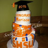 Shsu Graduation Cake Graduation cake for Sam Houston University. all fondant icing and accents. Gumpaste cap.