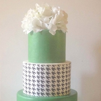 Houndstooth Wedding Cake Three tiered wedding cake, the middle is a houndstooth print, top and bottom tiers are color matched to the brides choice of emerald green...