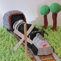 Retirement From The Cn. A vanilla bean cake with raspberry swiss meringue filling and vanilla bean smb. The train was made of rice krispie treats and fondant/...