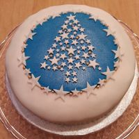 Christmas Cake Fondant covered fruit cake with white star Christmas tree motif