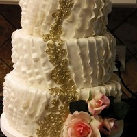 Ruffles And Roses And Applique MMF ruffles and applique. The bride requested silk flowers. Tiers are red velvet cake, lemon cake, and Italian cream cake.
