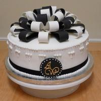 Black And White Bows   An elegant black and white bow-topped cake for a friends birthday.Pastillage monogram plaque on the front and pastillage bows on top.