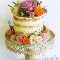 Naked And Floral Classic Vanilla Bean Naked cake with a variety of spring flowers <3