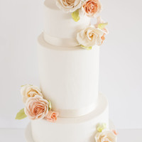 Peach & Cream Roses Wedding Cake A 3 tier wedding cake with simple peach and cream colored roses.