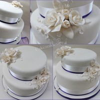 Wedding Cake this is a nut free fruit cake with a large vanilla sponge coated in ivory sugar with sugar roses
