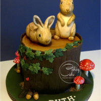 "Woodland Bunnies A deep triple layer 6"" vanilla cake sandwiched with whipped vanilla buttercream and decorated to look like a woodland tree stump with..."
