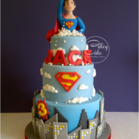 "Superman! Three tiers (8"" choc, 6"" vanilla, 4"" choc) decorated with a Superman Metropolis theme. Thanks to Custom Cutterz for..."