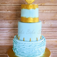 "Sea Shell And Ruffles Three tier (9""-7""-5"") cake made for a modern under the sea theme baptism. Aqua colored fondant covered tiers with ruffles,..."