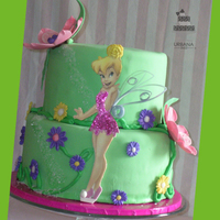 Tinkerbell Cake 2 tiered cake both of Neapolitan flavor. iced with bc then covered with green colored fondant. All flowers hand made to compliment the...