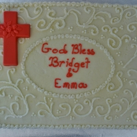 First Communion Cake   White cake filled with raspberry. Buttercream frosting. Chocolate cross.