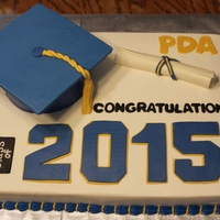 2015 Graduation Sheet Cake I used 2 9x13 cakes side by side, one chocolate and the other vanilla, to make this cake. I also used a 6-inch round for the graduation cap...